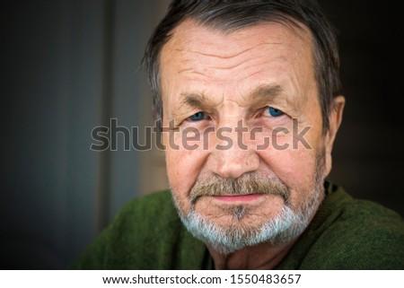 Sad pensive elderly man with mustache close-up portrait