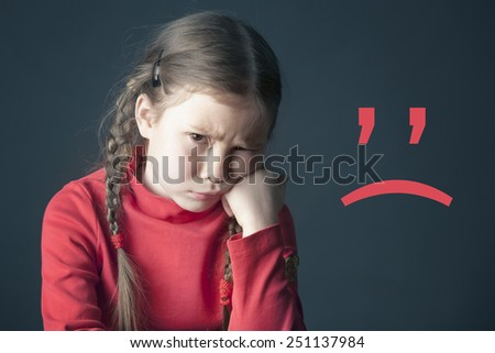 Sad pensive girl with pigtails and with the sad smile mark