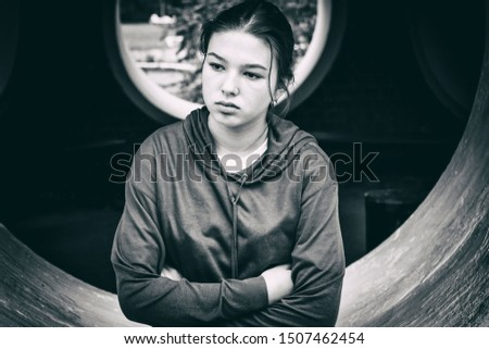 Sad pensive lonely girl teenager black and white portrait outdoor