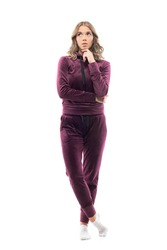 Sad pensive young pretty woman in home leisure wear sweatsuit looking up thoughtful. Full body length isolated on white background.