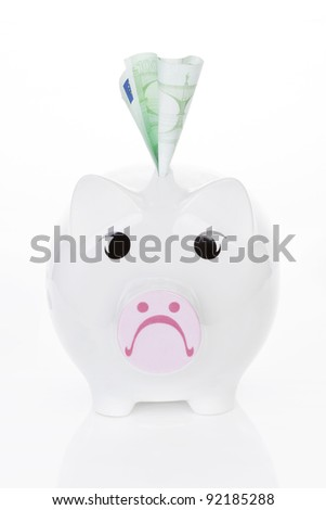 Sad piggy bank with hundred euro note isolated on white background. Savings concept.