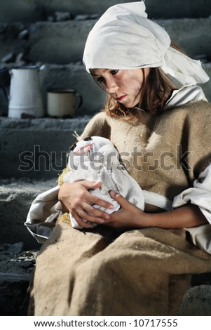 Sad poor girl wearing dirty vintage clothes, holding a smiling doll, similar available in my portfolio