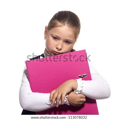 Sad School girl hold a book