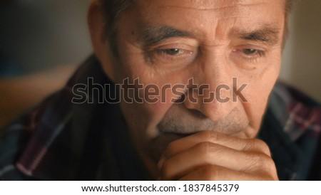 Sad senior man thinking, looking down. Closeup, shallow DOF. Stock photo ©