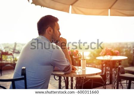 Sad single romantic man waiting for his date
