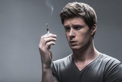 Sad smoker thinking about his nicotine addiction