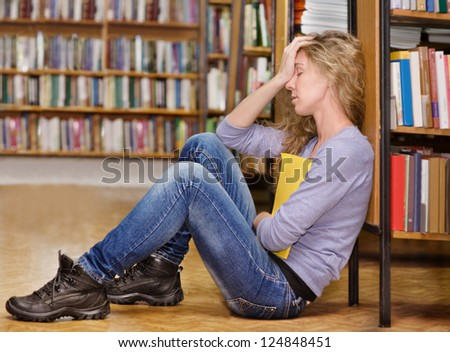 sad student in library