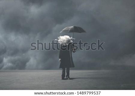 sad surreal man with cloud on his head