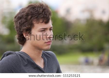 sad teenager looking away in outdoor