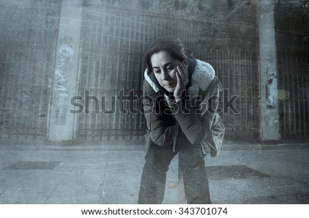 sad woman alone on street suffering depression looking desperate and helpless sitting lonely in dirty dark urban night background in female victim of abuse concept grunge dirty edit grunge dirty edit #343701074