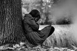 Sad woman crying after break up in the park