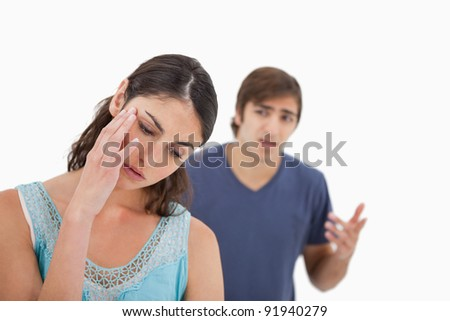 Sad woman mad at her boyfriend against a white background
