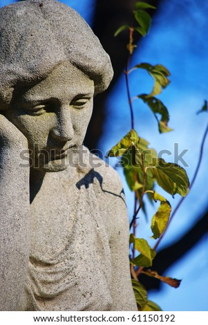 Sad woman-old tombstone on Central Cemetery in Vienna,Austria.