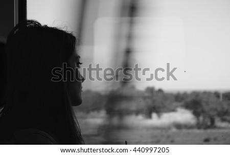 Sad woman traveling with train, alone. Concept of loneliness, sadness, depression.
