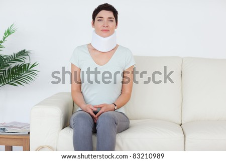 Sad Woman with a surgical collar in a waiting room