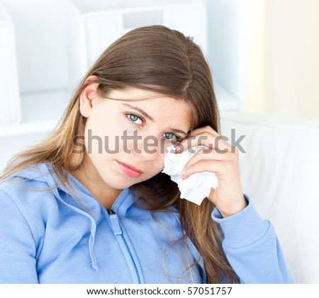 Sad woman with tissues looking at the camera