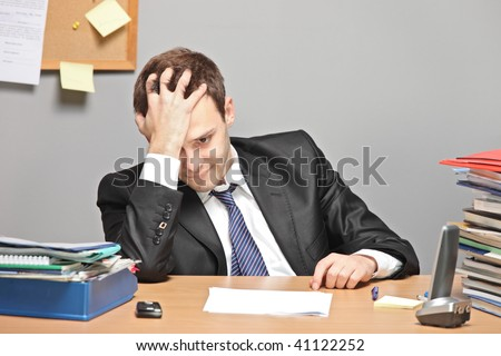 Sad worker in an office