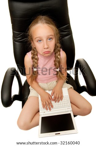 Sad young girl with laptop sitting on a chair