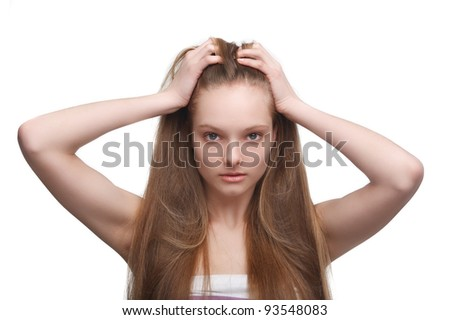 Sad young girl with long hair on white background - stock photo