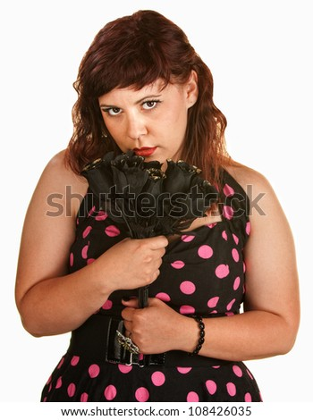 Sad young white woman holding black roses
