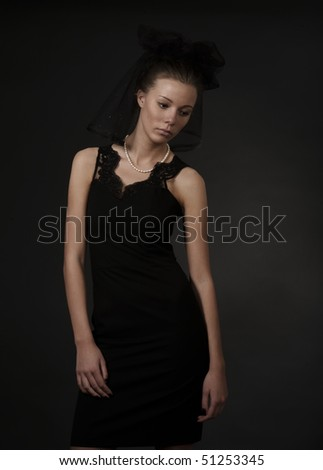 sad young woman in black