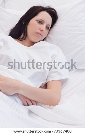 Sad young woman laying in the hospital