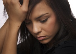 Sad young woman looking down( acting )