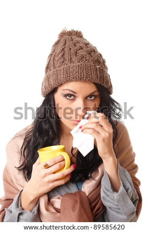 sad young woman with flu symptom holding a mug with a hot drink isolated on white background