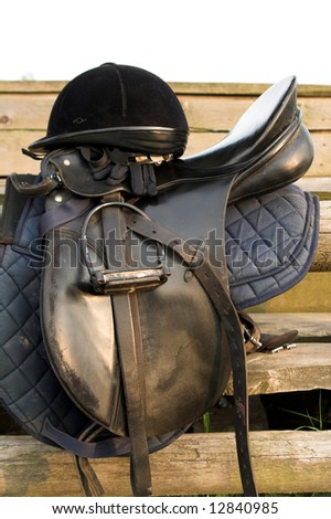 Saddle and hat resting - stock photo