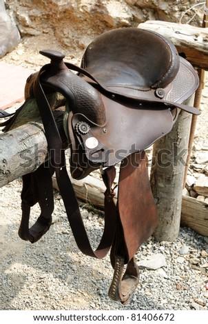 saddle horse on the fence
