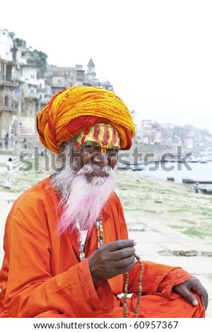 Sadhu at the ghats in Varanasi, India. With a pink beard from the traditional holi festival.
