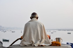 Sadhu praying at the ghats in Varanasi