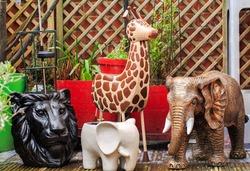 Safari Animal Plant Pots in an outdoor garden