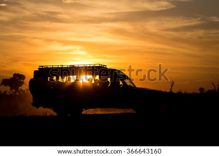 Safari car in sunset light\ Safari car in sunset light. Etosha National Park, Namibia, Africa.