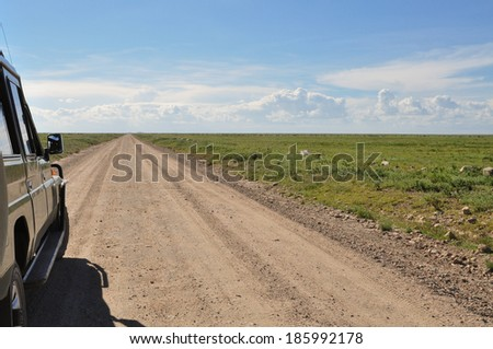 Safari car ready to start towards Serengeti plains right inside Serengeti National Park´s entrance gate.
