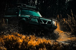 Safari suv. Mud and water splash in off the road racing. Off-road travel on mountain road. 4x4 travel trekking. Rally racing. Off road sport truck between mountains landscape