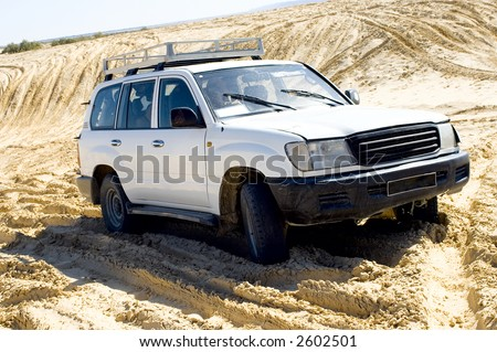 Safari truck, staying at the desert, a view from front, very bright light.