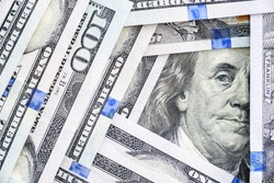 Safe-haven currency for investment, financial concept : Pile of US 100 USD dollar banknotes, depict most popular asset for central bank reserve / global money for using, paying or trading in the world