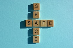 Safe, Space, words in wooden alphabet letters isolated on blue background