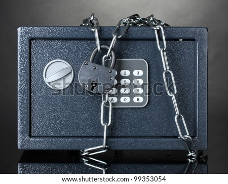 safe with chain and lock on grey background