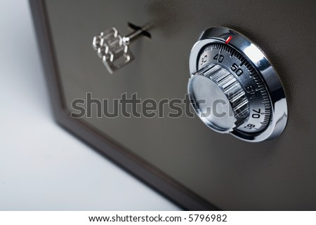 Safe with key lock and combination lock