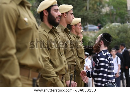 Safed,Israel May 1,2017 Israeli soldiers stand guard during a ceremony at the cemetery ,as Israel mark Memorial Day,commemorating the deaths of Israeli soldiers killed,and Israeli victims of terror #634033130