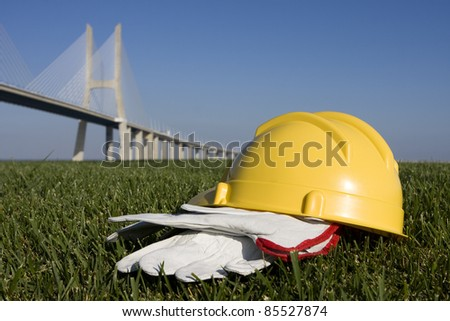 Safety concept on construction places - Yellow helmet and gloves