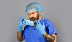 Safety. Coronavirus epidemic. Infection incubation period. Qualified medicine staff. Doctor wear respiratory mask. Surgeon surgery operation. Respiratory infection. Virus infection. Risk Taker.