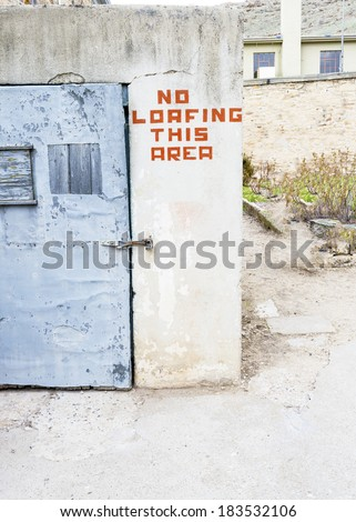 Safety door and warning sign on a wall