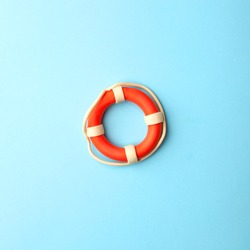 Safety equipment, life buoy or rescue buoy on blue background, minimal summer concept