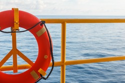 Safety equipment, Lifebuoy or rescue buoy stand by sea to rescue people from drowning man on production platform ,Energy and petroleum industry sea offshore