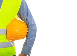 Safety equipment. Man with safety vest and yellow hard hat on white background