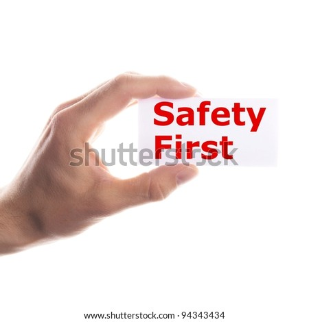 safety first concept with hand word and paper