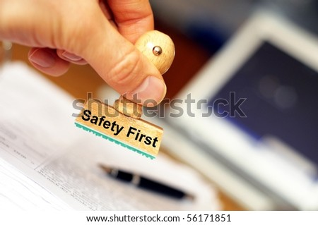 safety first concept with stamp in insurance office